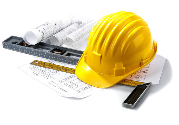 Collage of construction related items - blueprints, T-square, level, and safety helmet